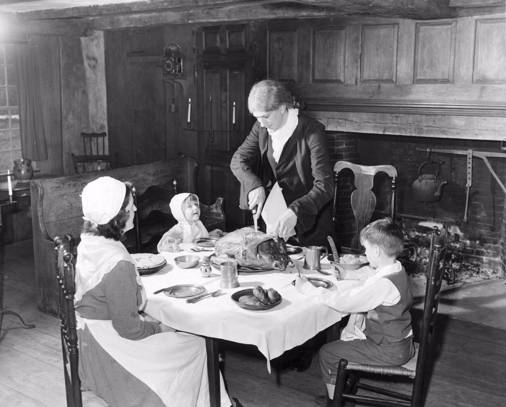 Stock Photo: 255-39901 Family at a dining table on Thanksgiving Day, Old Sturbridge Village, Sturbridge, Massachusetts, USA