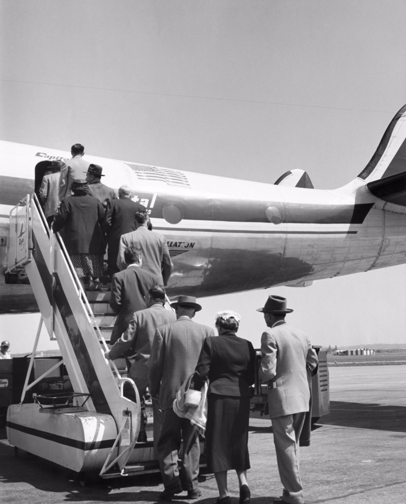 Stock Photo: 255-40490 Passengers boarding an airplane