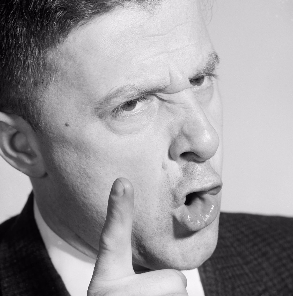 Stock Photo: 255-416572 Displeased man gesturing, close-up
