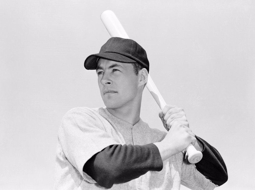 Stock Photo: 255-416708 Baseball player holding bat