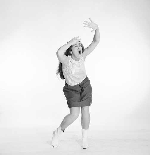 Stock Photo: 255-418583 Young woman dancing and singing