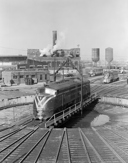 Stock Photo: 255-418762 USA, New York, Jersey Central diesel engine on turntable in railroad yard