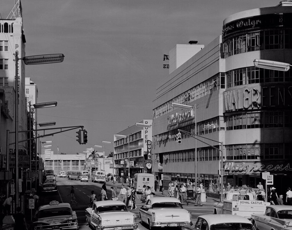 USA, Florida, Miami, Traffic and pedestrians on East Flagler Street : Stock Photo
