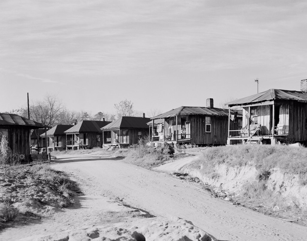 Stock Photo: 255-420733 USA, Alabama, Phenix City, Wooden houses near dirt road