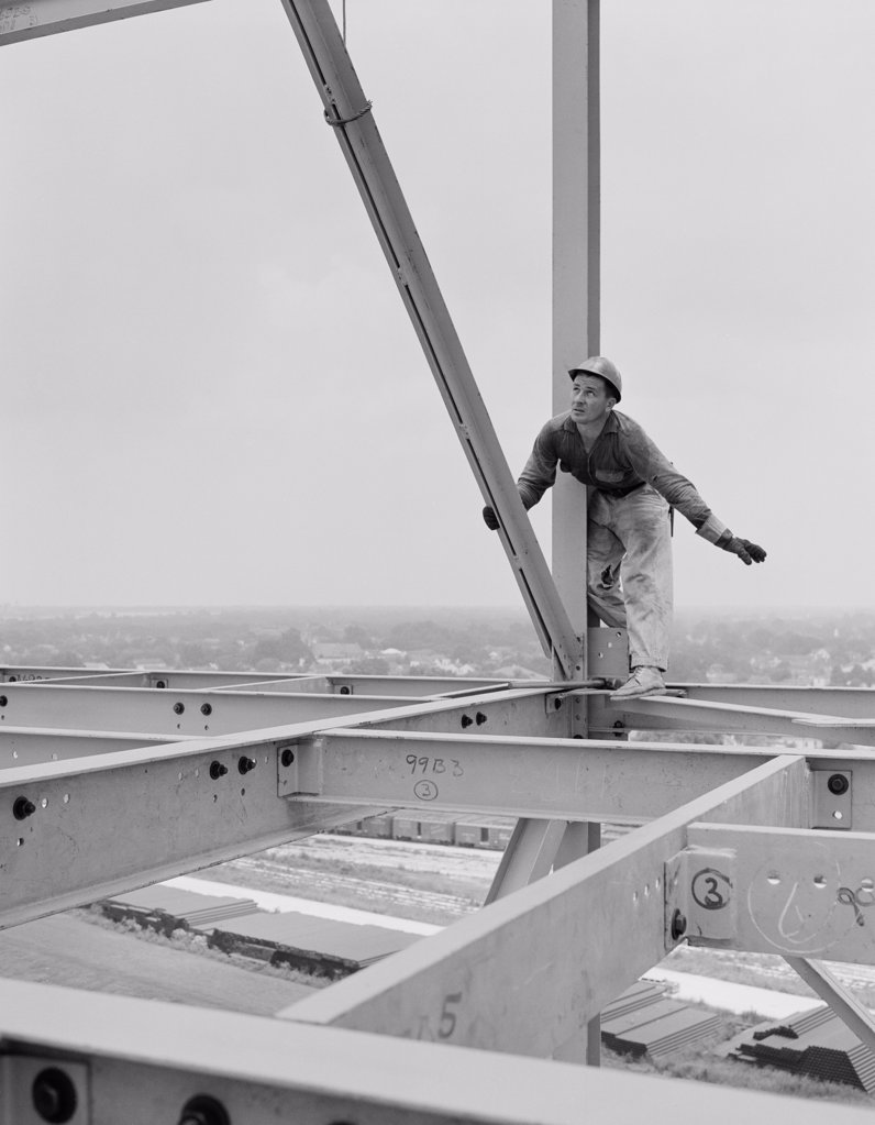 Stock Photo: 255-421928 Man working on construction site