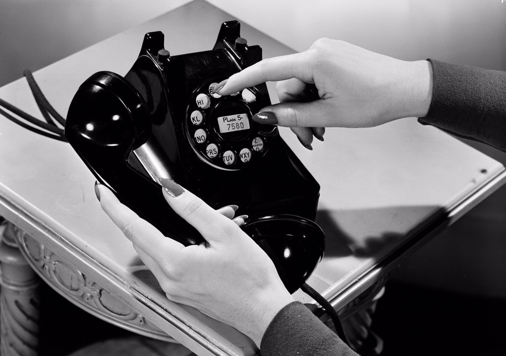 Stock Photo: 255-422451 Woman holding vintage telephone