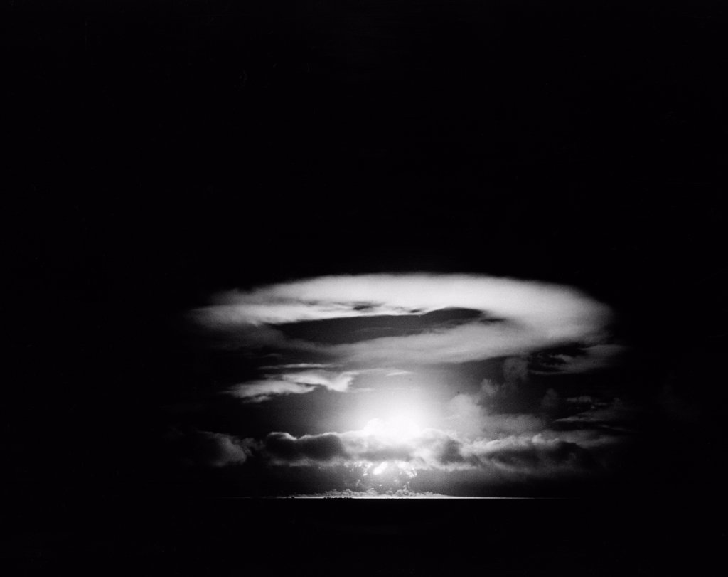 Stock Photo: 255-422510 Pacific Ocean, Eniwetok Atoll, Fire ball of nuclear detonation rises through clouds during tests in 1951