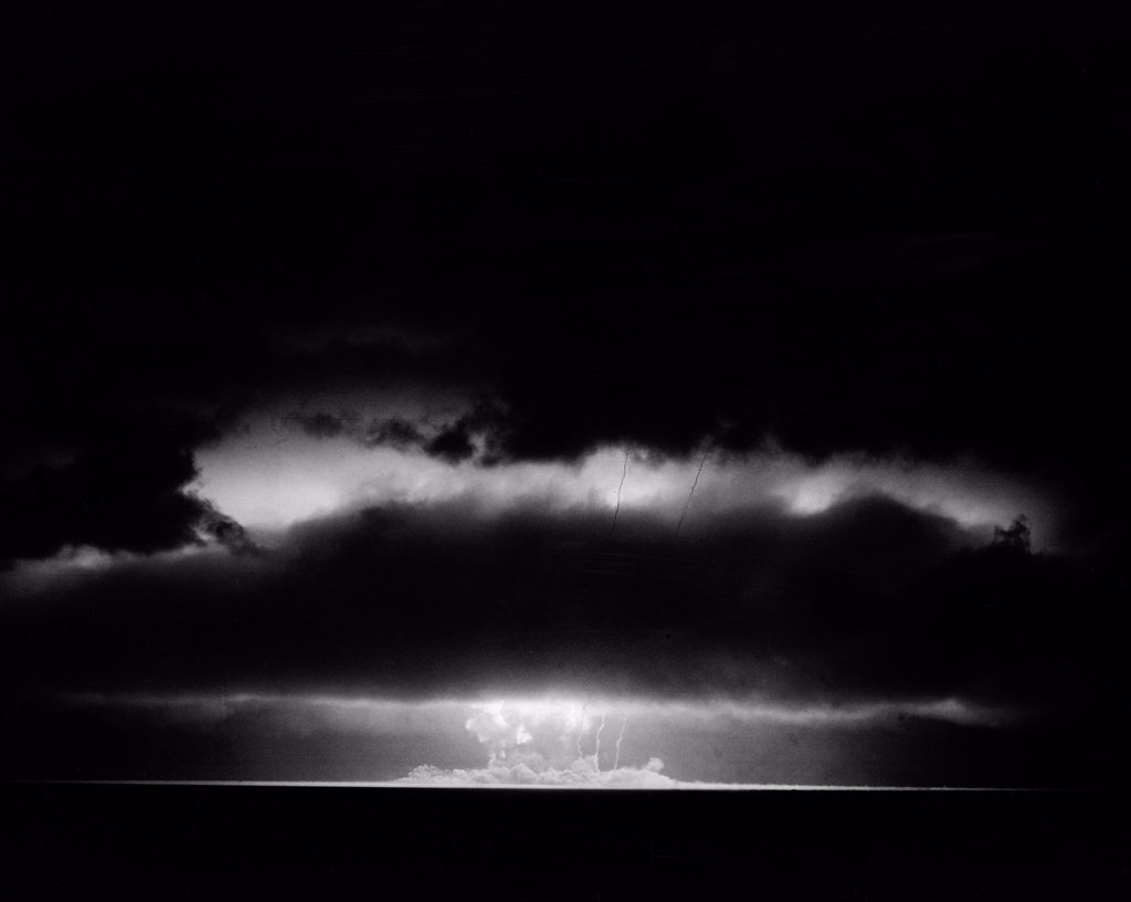 Stock Photo: 255-422515 Pacific Ocean, Eniwetok Atoll, Fire ball of nuclear detonation rises through clouds during tests in 1951