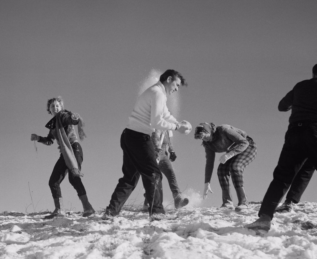 Stock Photo: 255-422709A Young people playing with snow