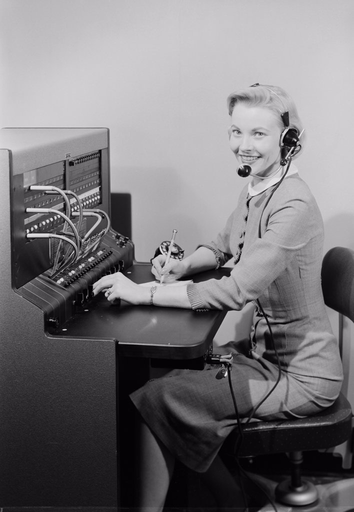 Stock Photo: 255-422812 Studio portrait of telephone switchboard operator