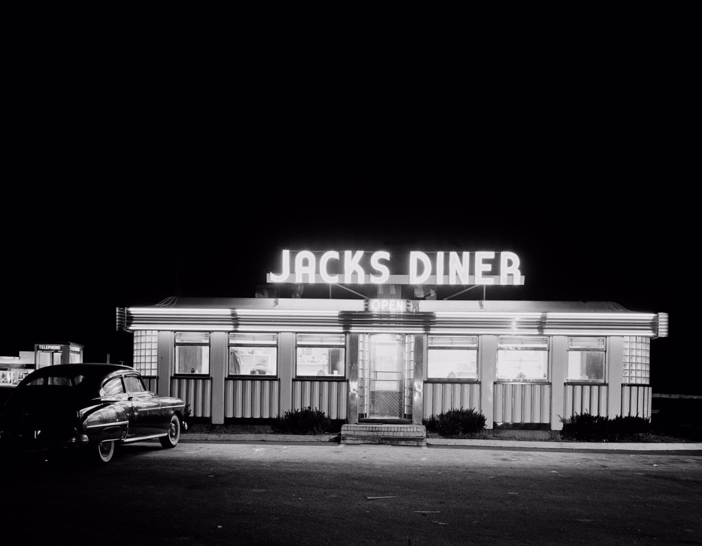 Stock Photo: 255-423054 USA, New Jersey, Peramus, Modern diner off highway at night