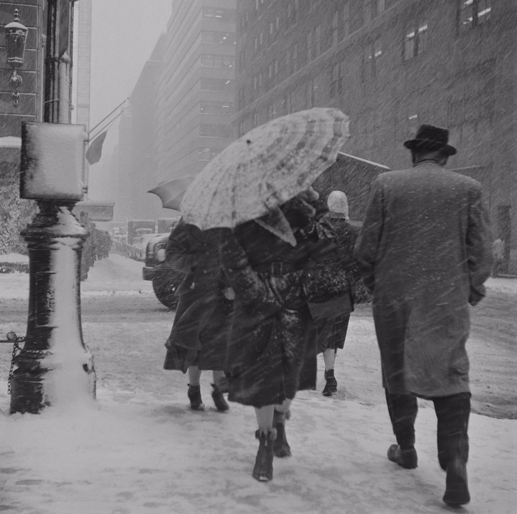 USA, New York City, People walking in snowstorm : Stock Photo