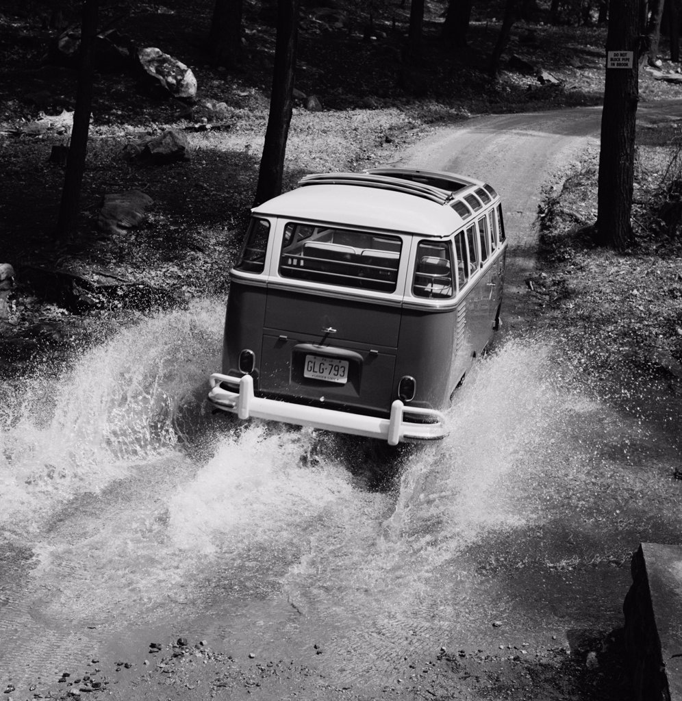 Stock Photo: 255-424160 USA, New Jersey, Van in flood water on country road
