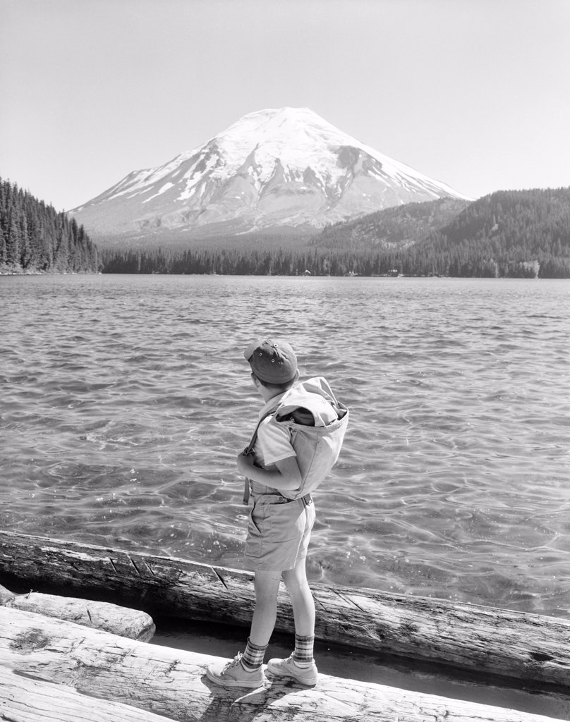Stock Photo: 255-424476 USA, Washington State, boy looking at Mountain Saint Helens and Spirit Lake