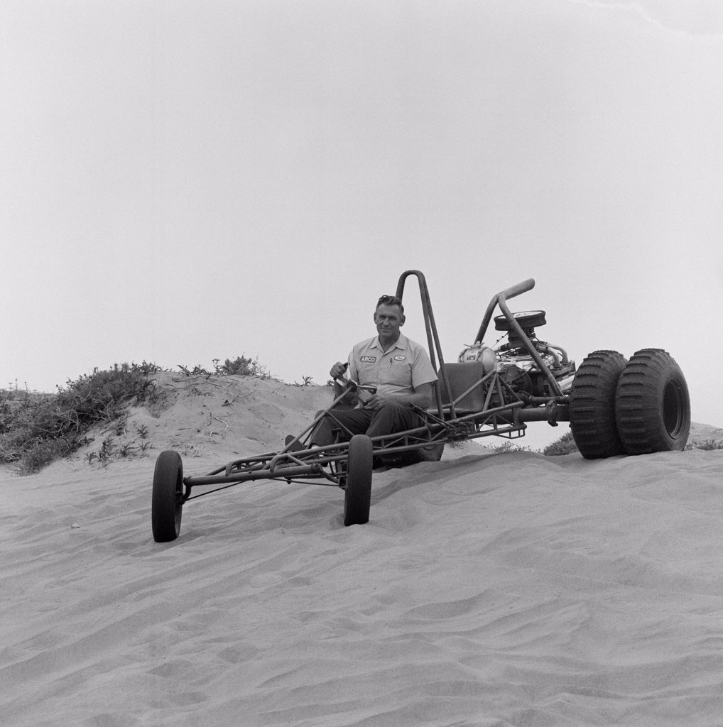 Stock Photo: 255-424925 Man riding beach buggy on sand dunes