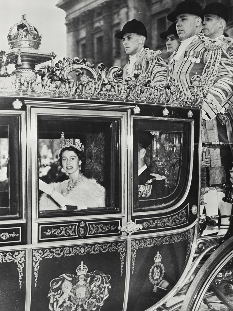 Queen Elizabeth II enroute to opening her first Parliament on November 4, 1952 in London, England : Stock Photo