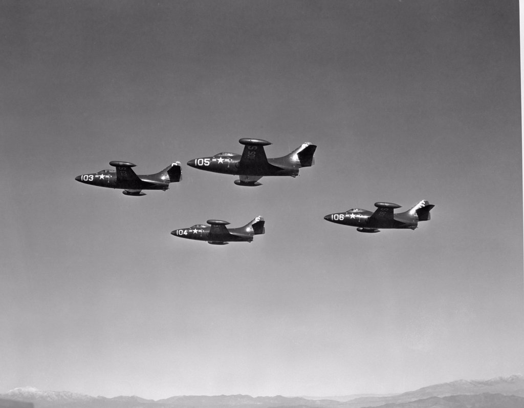 Stock Photo: 255-44066 Low angle view of four fighter planes flying in formation, F9F Panther
