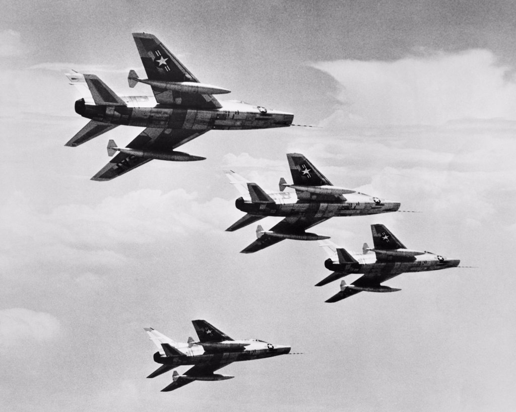 Stock Photo: 255-44086 Low angle view of four fighter planes flying in formation, F-100 Super Sabre