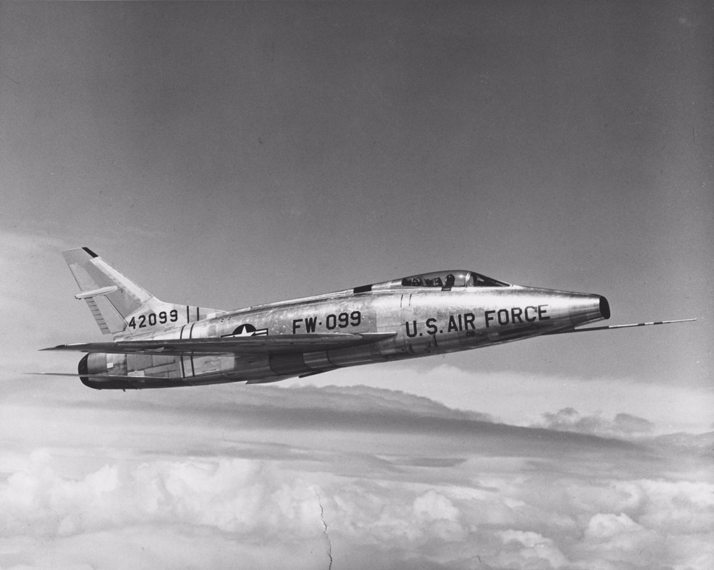 Stock Photo: 255-44099 Side profile of a fighter plane in flight, F-100C Super Sabre