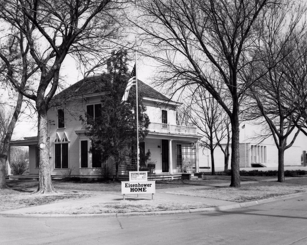 Flag in front of a house, Dwight D. Eisenhower Family Home, Abilene, Kansas, USA : Stock Photo