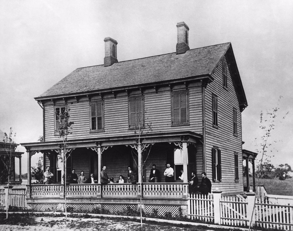 Groups of people on a porch, Sarah Jordan Boarding House, Menlo Park, New Jersey, USA : Stock Photo