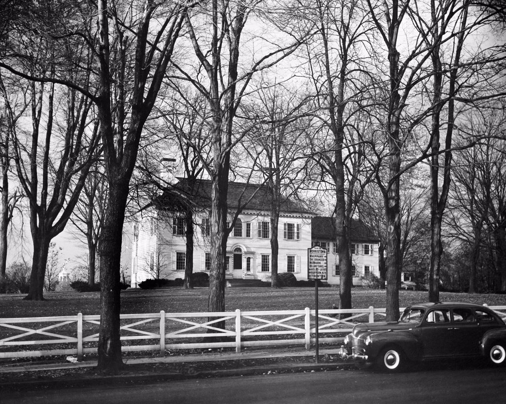 Bare trees in front of a mansion, Ford Mansion, Morristown, New Jersey, USA : Stock Photo