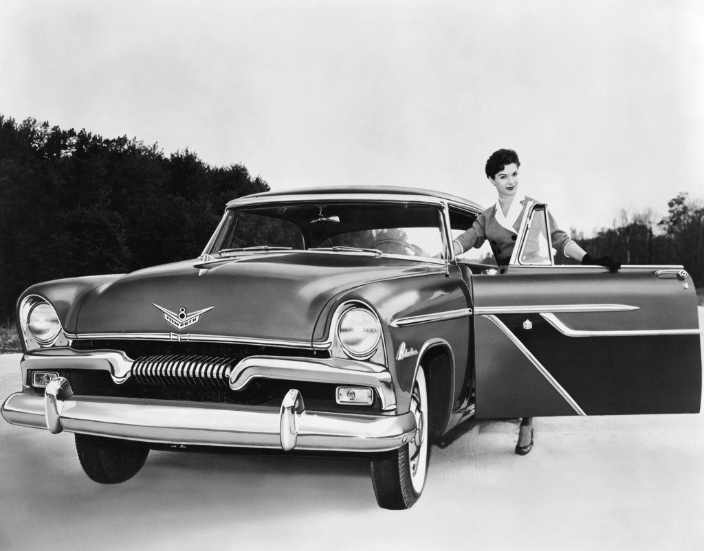 Stock Photo: 255-4558 Woman opening a car door of a 1955 Plymouth Belvedere sport coupe