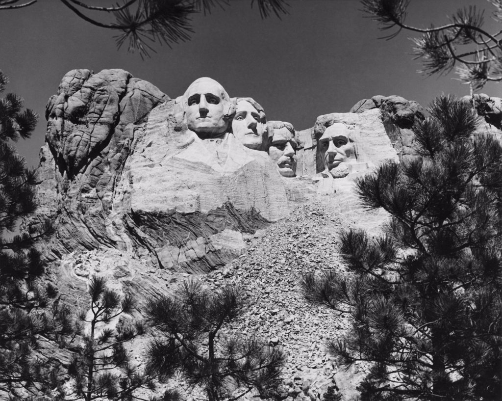 Stock Photo: 255-46204 USA, South Dakota, Mount Rushmore National Memorial, low angle view of sculptures of US Presidents carved in mountain
