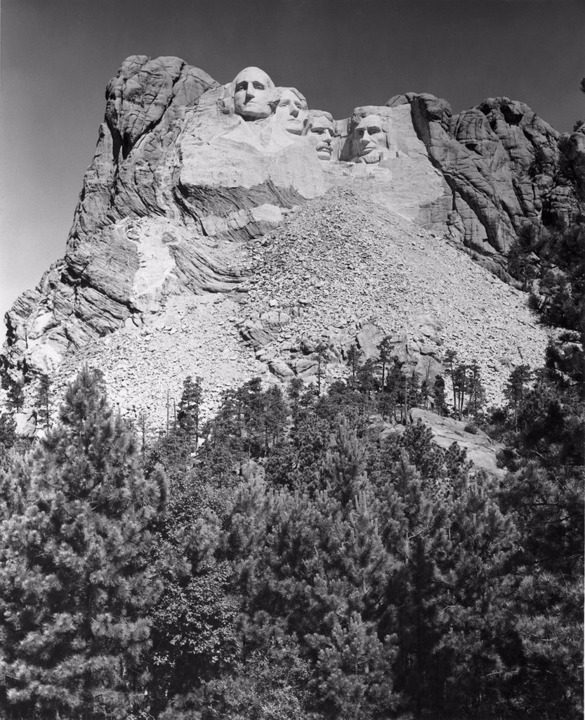 Stock Photo: 255-46215 USA, South Dakota, Mount Rushmore National Memorial, low angle view of sculptures of US Presidents carved in mountain