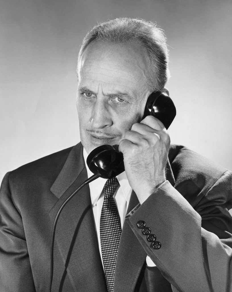 Close-up of businessman using telephone : Stock Photo