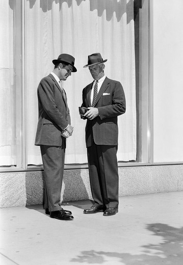 Businessmen talking in street : Stock Photo