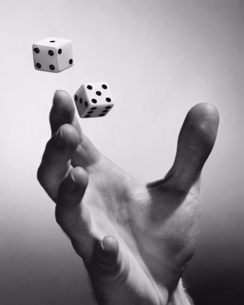 Stock Photo: 255-49395 Close-up of a person's hand tossing two dice