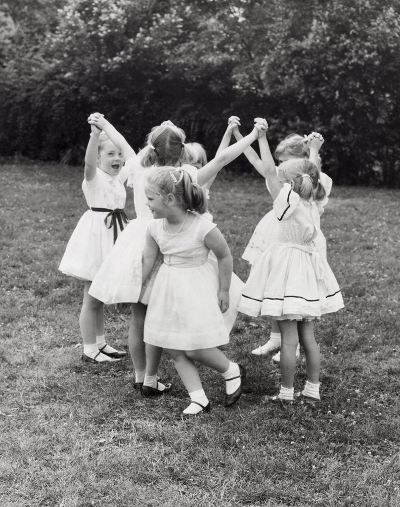 Stock Photo: 255-4993 Group of girls playing outside