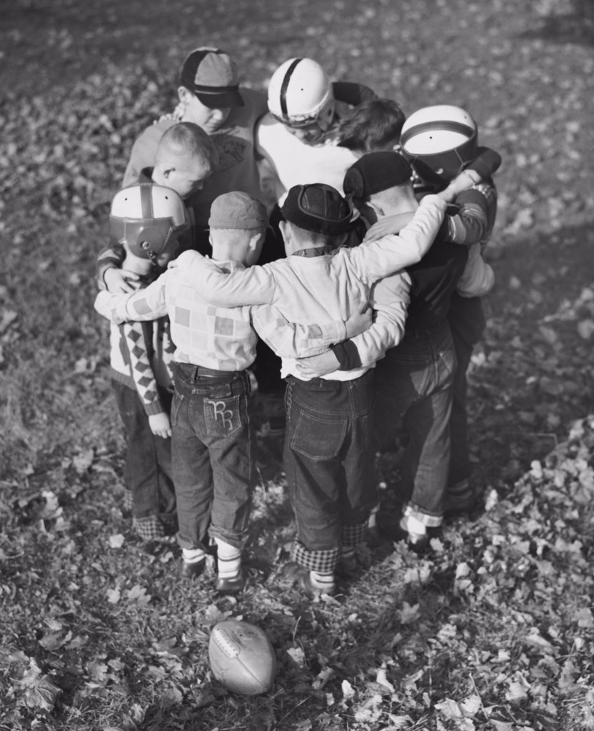 Stock Photo: 255-50102 High angle view of boys standing in a huddle