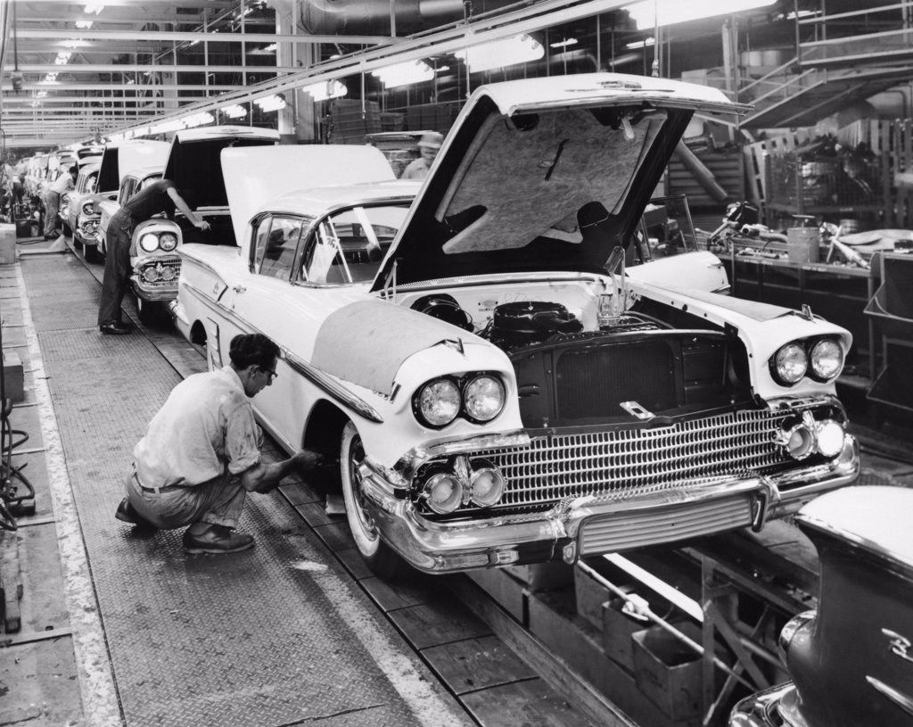 Stock Photo: 255-5457 Workers working on assembly line of cars, Chevrolet Motor Division, Detroit, Michigan, USA