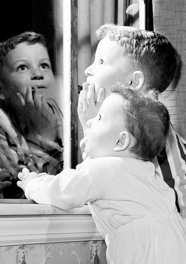 Stock Photo: 255-5607 Two kids looking through window