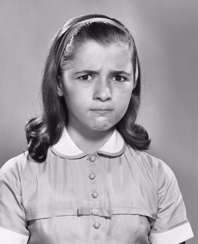 Stock Photo: 255-6185 Portrait of a girl looking displeased