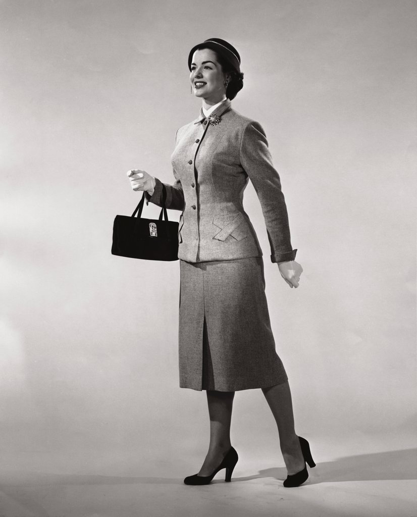 Stock Photo: 255-7236 Young woman carrying a hand bag