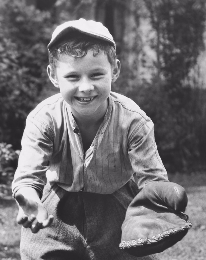 Stock Photo: 255-7356 Boy wearing a baseball glove