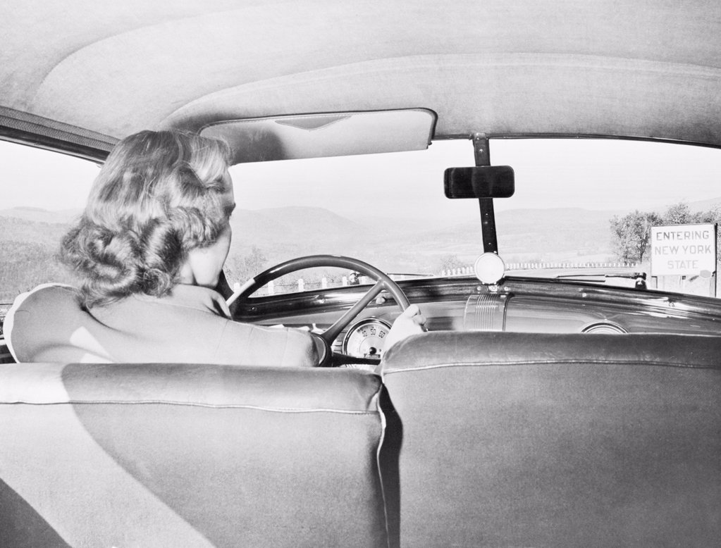 Stock Photo: 255-7547 Rear view of a woman driving a car