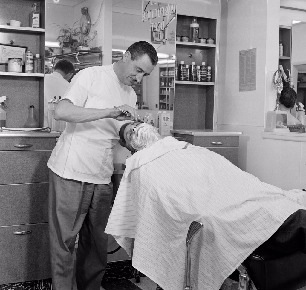 Stock Photo: 255-7862 Barber shaving a mid adult man in a hair salon