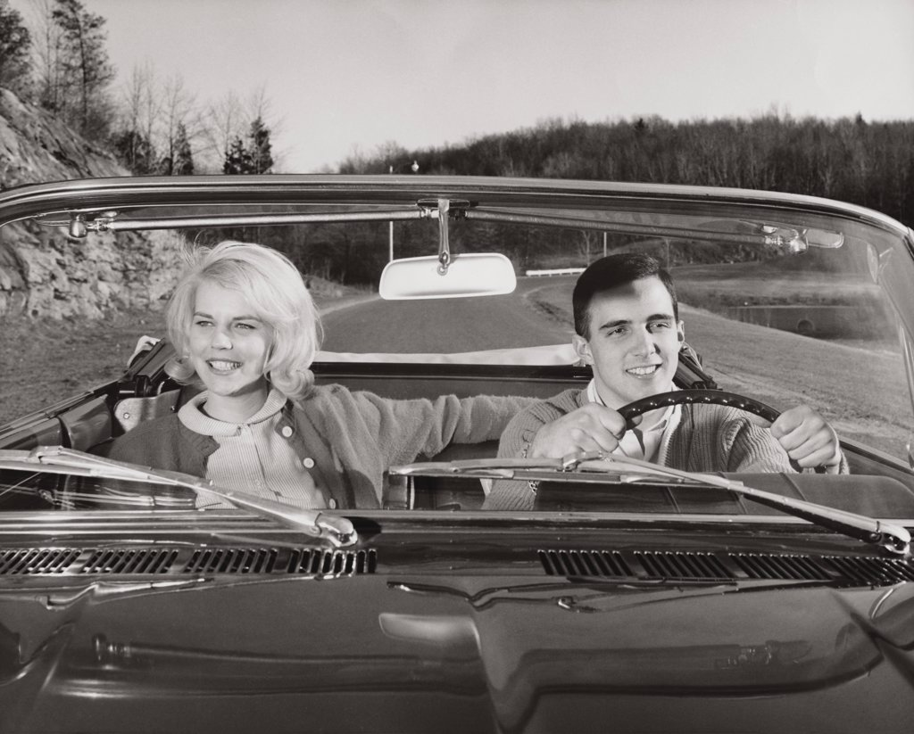 Stock Photo: 255-7921 Close-up of a young couple sitting in a car