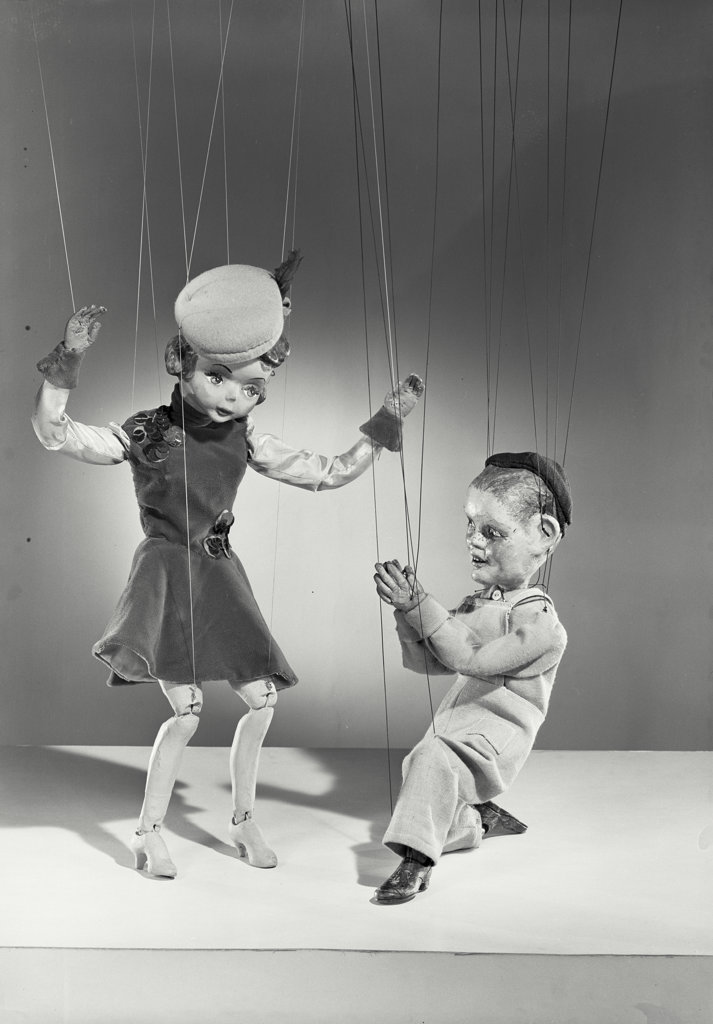 Two marionettes dancing : Stock Photo