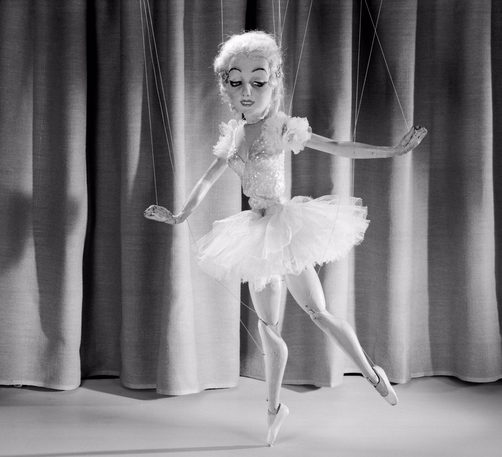 Female marionette dancing : Stock Photo