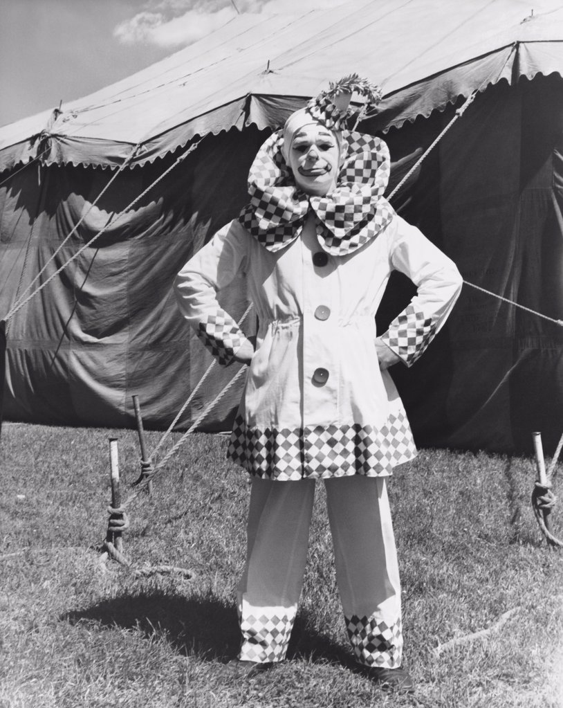 Stock Photo: 255-8183 Clown standing with arms akimbo in front of a circus tent