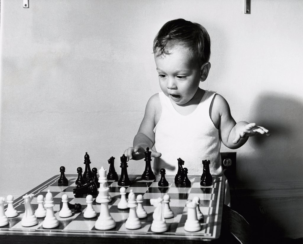 Stock Photo: 255-819 Close-up of a boy playing chess