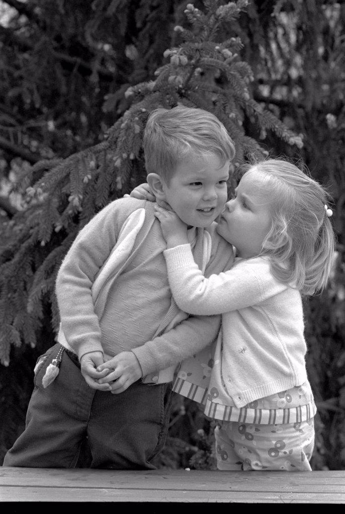 Stock Photo: 255-857 Little girl kissing boy