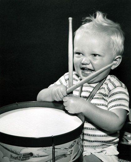 Baby playing drums : Stock Photo