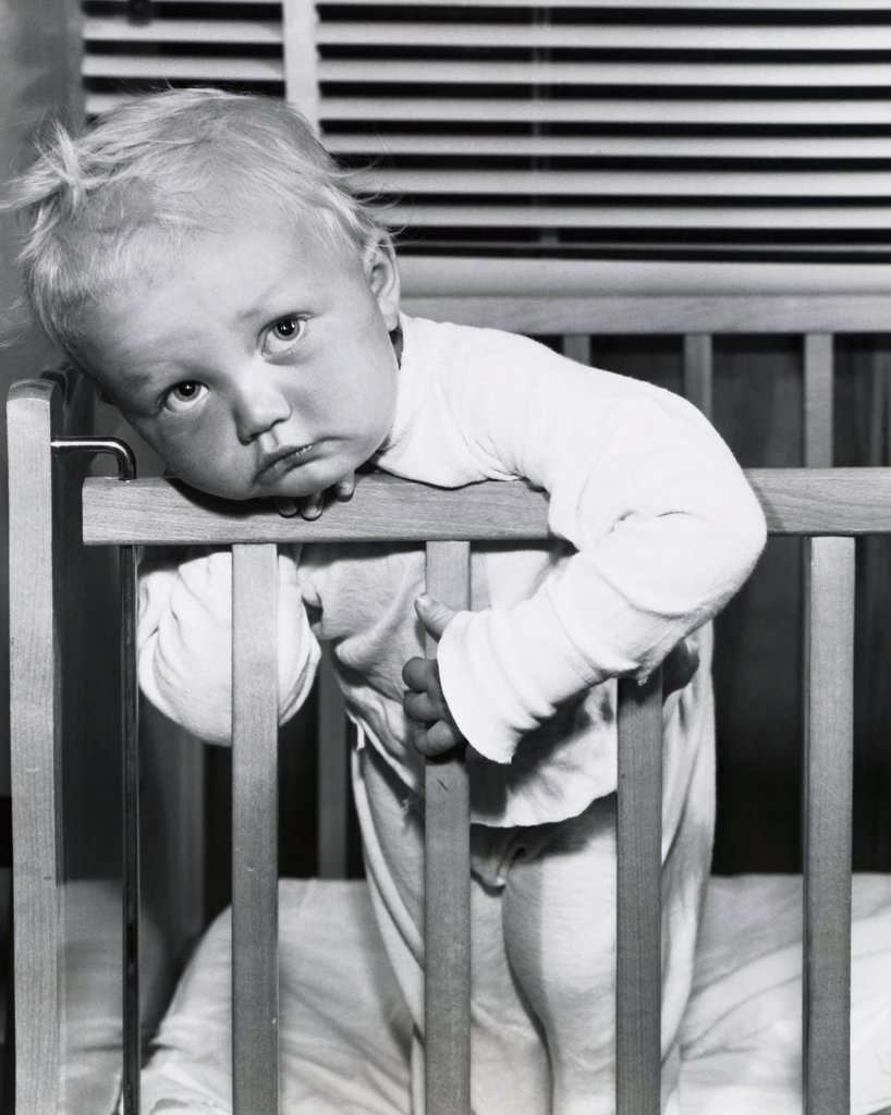Stock Photo: 255-9650 Close-up of a baby boy leaning over a crib