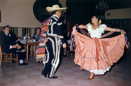 Dancers performing dance in a restaurant, Mexico : Stock Photo
